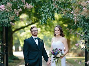 Anna and Nate's informal, casual wedding was accented by a color palette of emerald green and navy.
