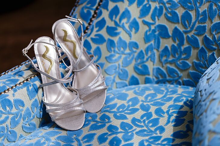 The bride wore a pair of silver strapped shoes with a low heel by Nina and was purchased at DSW.