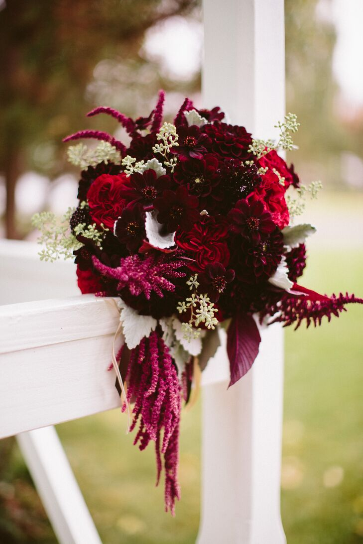 """""""Our flowers were rich in color, texture and shape,"""" Paulina says. Her bouquet incorporated burgundy dahlias, chocolate cosmos, and red hanging amaranthus and was tied with burlap and ribbon. """"We included a simple variety of berries, herbs (rosemary and thyme) and eucalyptus as accents."""""""