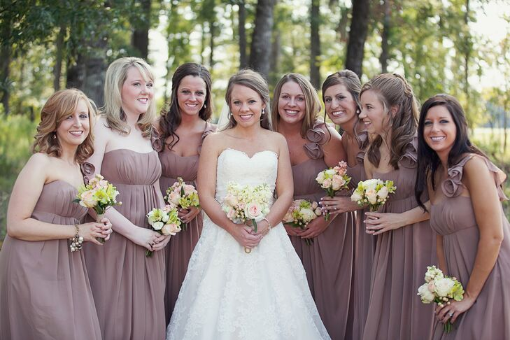 The bridesmaids wore long chiffon gowns in an earthy hue. The dresses had subtle sweetheart necklines and flowing pleats that gathered at the bodice.