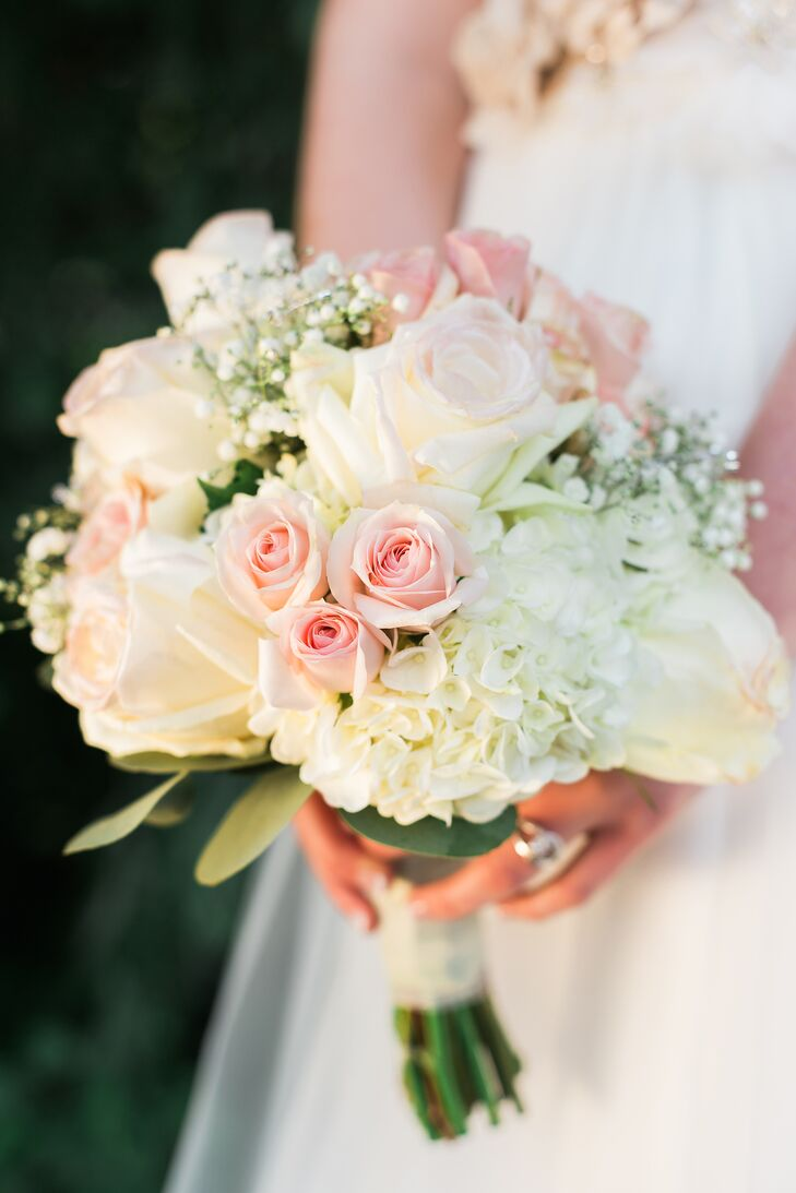 The bride's bouquet took inspiration from the rosettes in her sash and incorporated pink and white roses with hydrangeas and silver-dollar eucalyptus.
