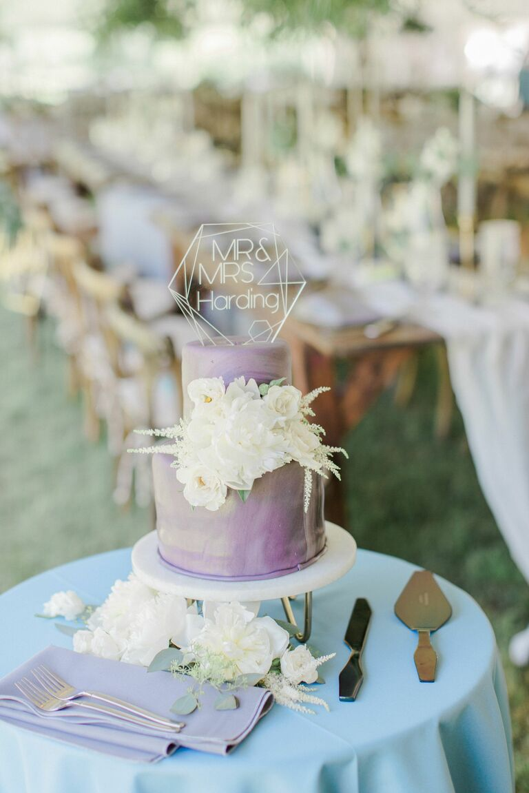 iridescent purple and white modern wedding cake with acrylic cake topper