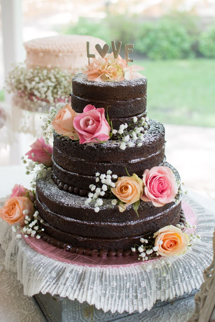 Jake's mother baked all the wedding cakes for the couple. They had one, three-tiered naked chocolate ganache cake along with three blush, single-tiered cakes with different fruit fillings.