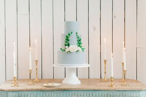 Blue-Gray Tiered Wedding Cake with Elegant Laurel Wreath Design