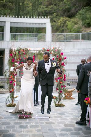 Elegant Ceremony With Wedding Arch and Pink Flowers