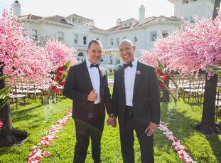 "Edgar Martinez (42 and a wedding designer and florist) Macio Oliveira (37 and a banquet manager) said ""I do"" at the opulent Dolce Hayes Mansion in San"