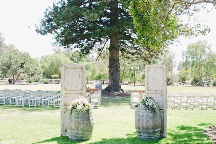 Two faded panels of wood leaned up against wooden barrels outside, marking the entryway going into the ceremony space. Because the surrounding landscape at Camarillo Ranch in Camarillo, California, was  beautiful, little to no additional decor had to be added.