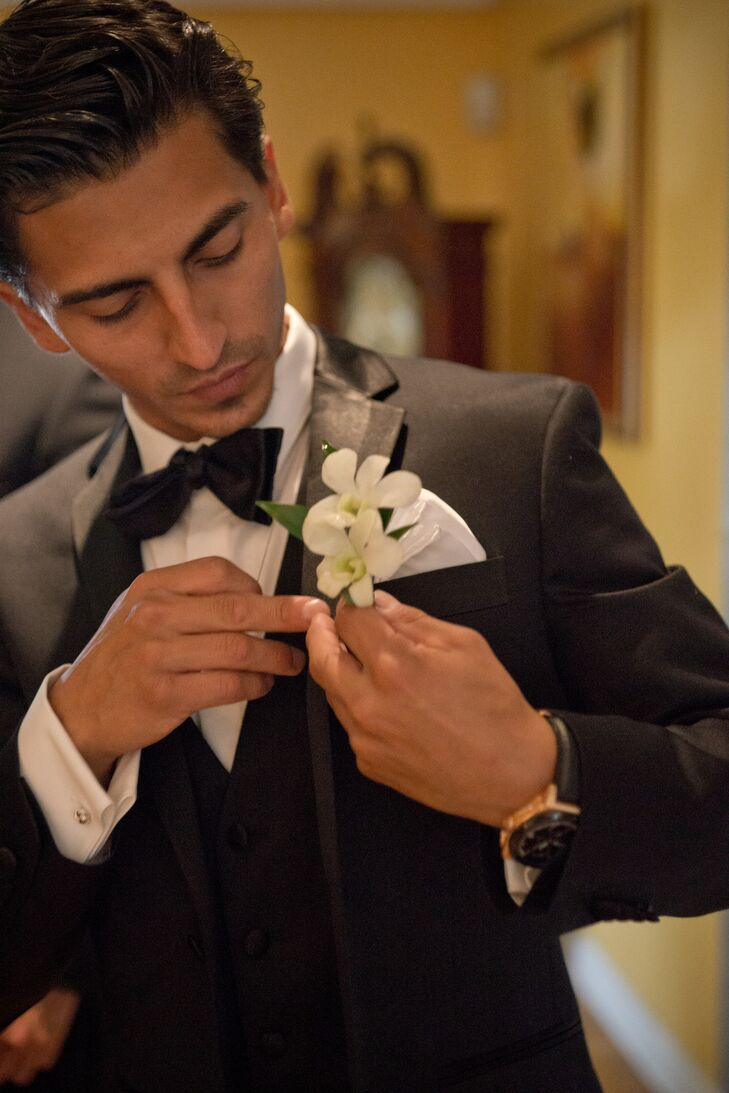 Esteban wore an elegant white floral boutonniere.