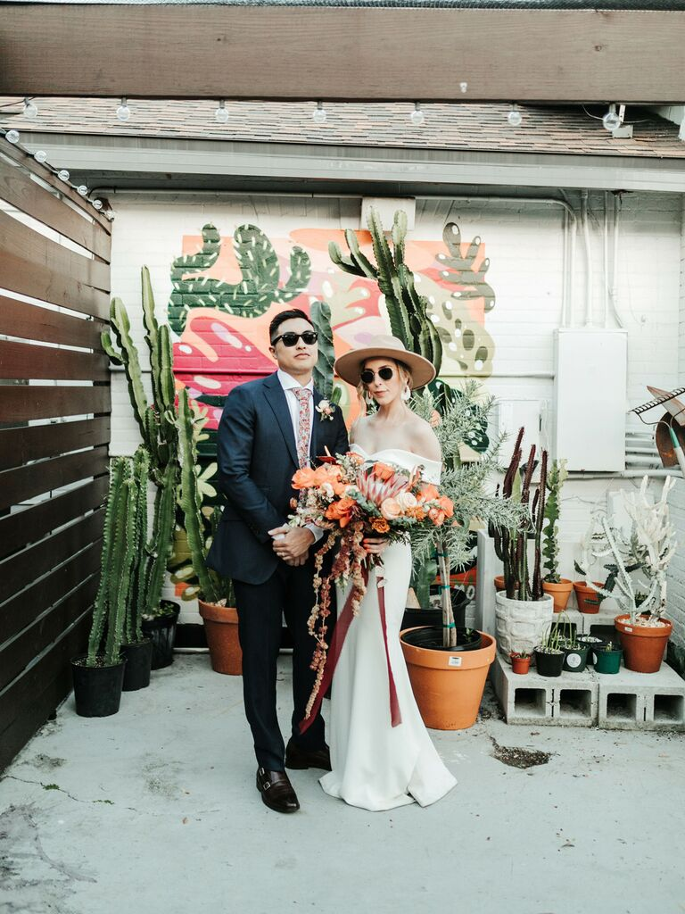 how to choose wedding vendors/couple in sunglasses