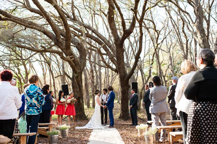 Sarah and Sean completely personalized their ceremony space. They let the woods on their friend's family's farm in DeLand, Florida, serve as the backdrop. Galvanized buckets filled with baby's breath lined the aisle alongside an ivory runner. Their 175 guests even took their seats on wooden benches made by Sean and his friend.