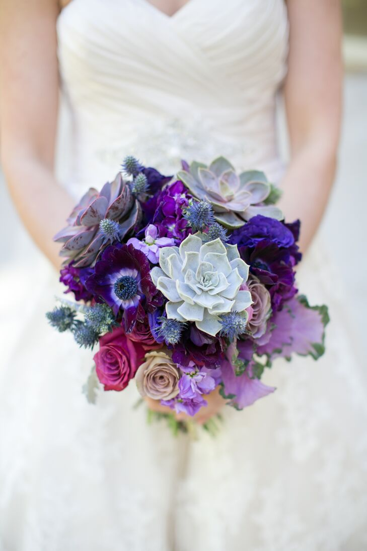 """""""I wanted an organic feel with unusual flowers in blues, lavender, purple and greenery, somewhat unstructured, that would complement the blue bridesmaid dress color,"""" Alyse says of the bouquets, which incorporated an array of blooms, along with succulents and thistle."""