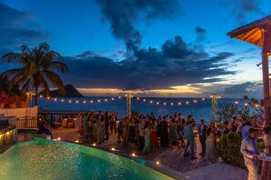 Tropical Waterfront Reception with String Lights at Cap Maison in Saint Lucia