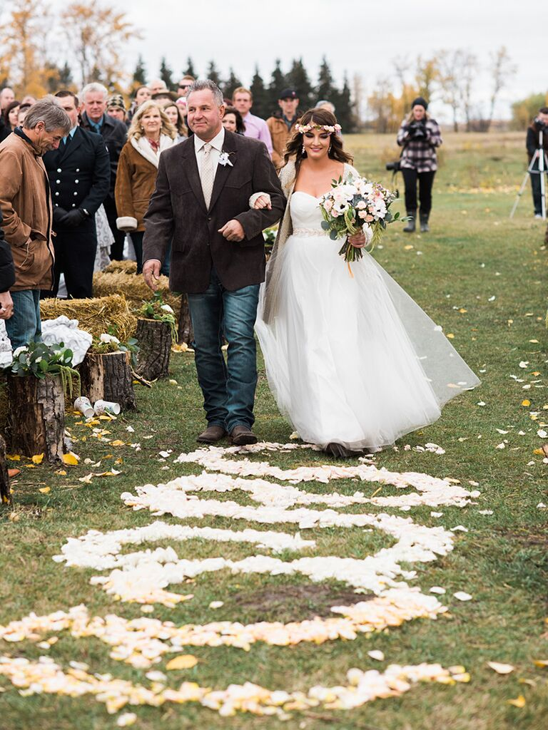 Rustic wedding ceremony aisle decor with patterened rose petals