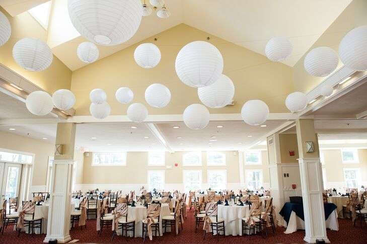 White paper lanterns added a whimsical touch to the indoor wedding reception at The Bay Pointe Club.