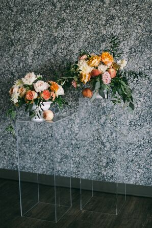 Blush, Ivory and Peach Arrangements Accented by Fruit on Acrylic Stands