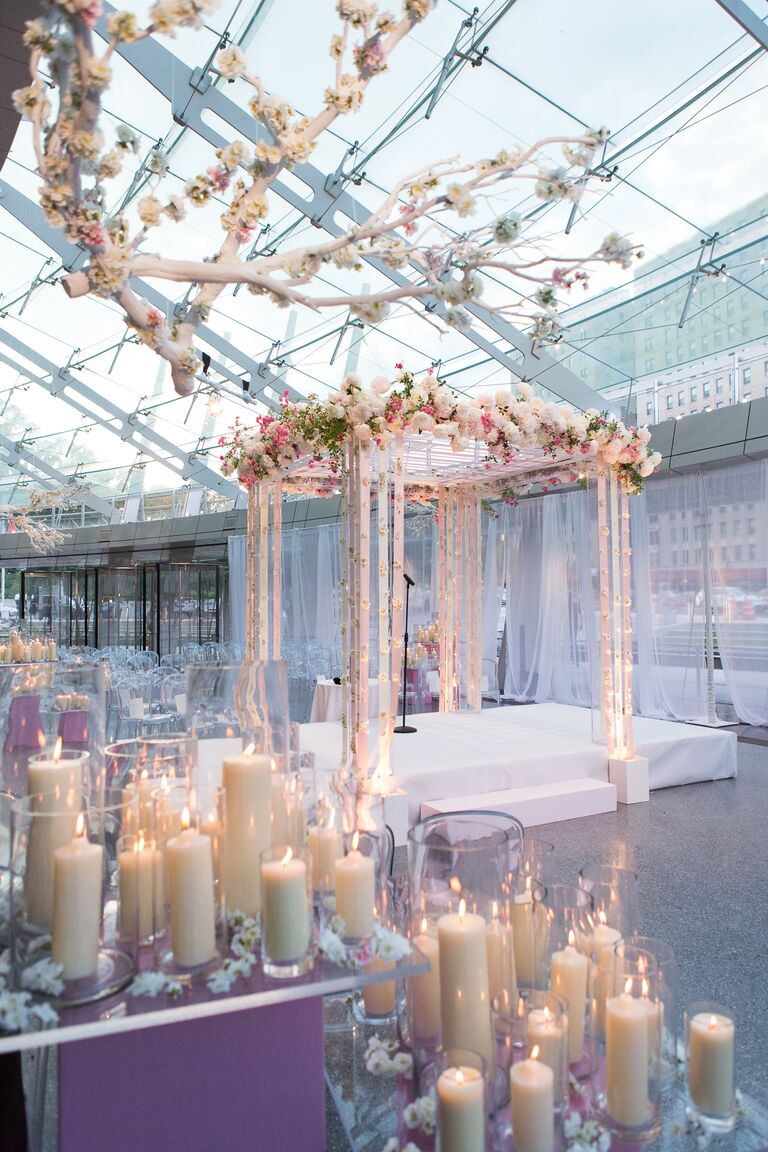 Lucite chuppah was decorated with peonies and blush and ivory ribbon