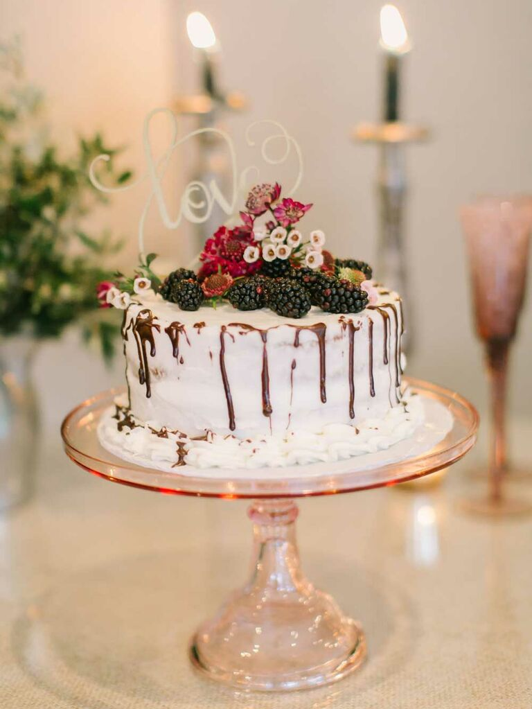 Small semi-naked wedding cake with chocolate drip