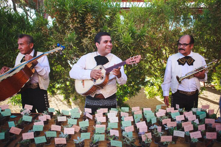 As guests arrived to the reception, they were greeted by a lively mariachi band, filling the air with their festive, upbeat music.