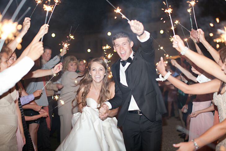 The couple exited their ceremony to guests holding sparklers above them.