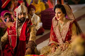 Traditional Red and Gold Punjabi Bride and Groom Attire