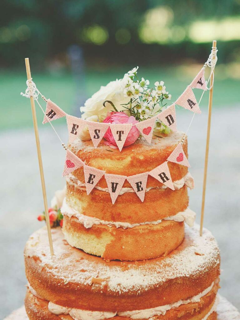 Naked cake with burlap banner cake topper
