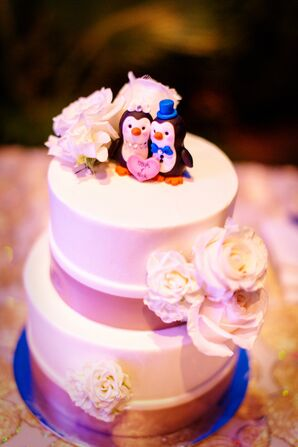 White Wedding Cake With Penguin Topper