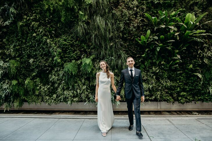 """For their modern wedding, Madie Hodges and Thomas Cyr had a funky """"bohemian, greenhouse library theme with a nod to the Beatles."""" They tied the knot a"""