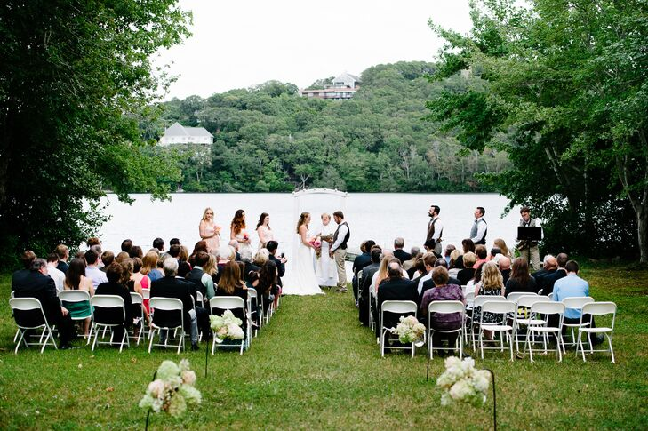 The ceremony was held in Dennis, MA in Meredith's neighbor's backyard. The outdoor space offered beautiful views of the lake, as well as acres of lush greenery.