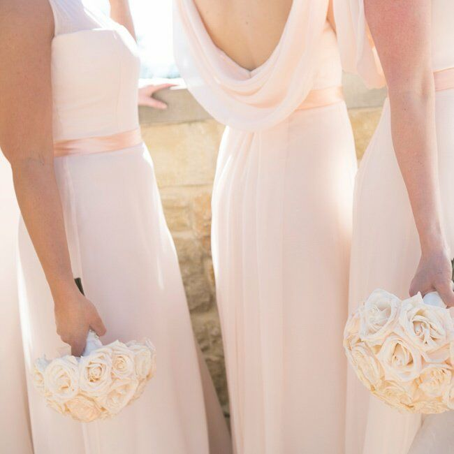 The bridesmaids wore elegant gowns with illusion necklines and draped backs in a soft shade of blush.