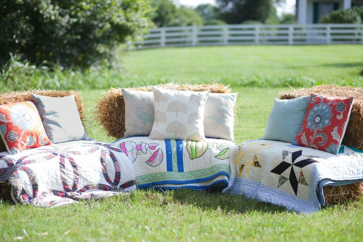 Comfy quilts and printed pillows covered haystacks to create a down-home country lounge area where guests could sit back, relax and enjoy the afternoon sunshine.