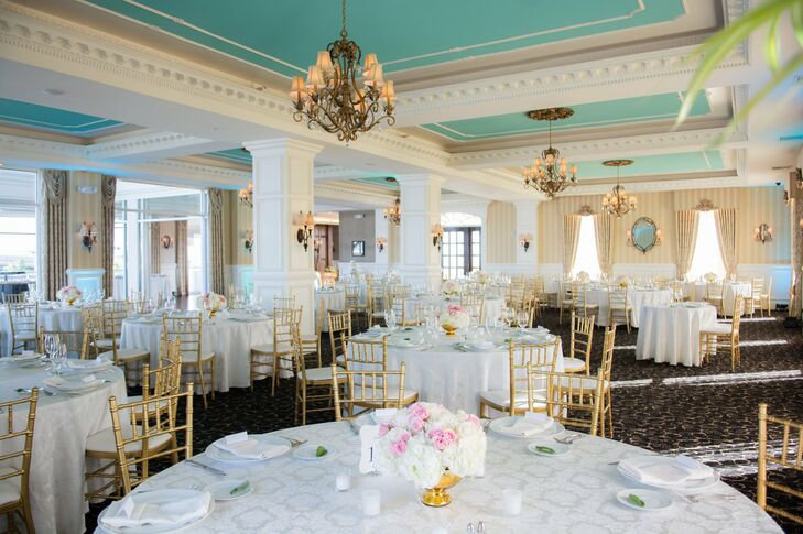 The ballroom at the Mallard Island Yacht Club was the perfect setting for the newlywed's elegant reception. They kept the color palette simple with shades of white, ivory and pink. The robin's egg blue ceiling added a fresh pop of color to the space.