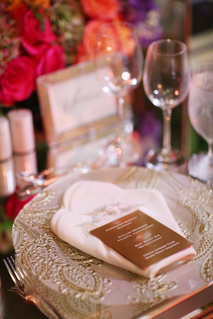 Ornate Metallic Place Settings with Menus and Patterned Plates and Napkins