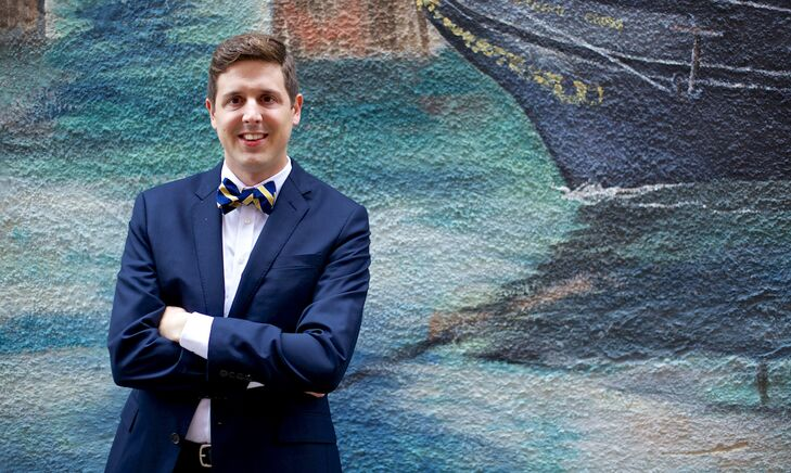 Tradd wore a dark navy Ludlow suit from J. Crew with a striped navy and gold bow tie from The Tie Bar.