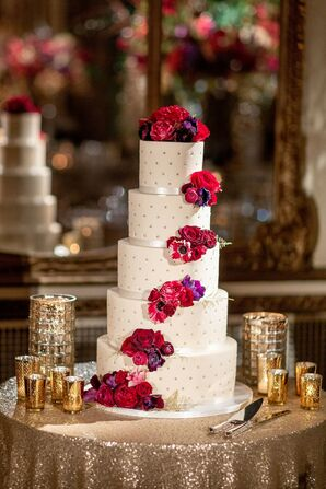 Glamorous Tiered Cake with Dotted Fondant and Red and Purple Flowers