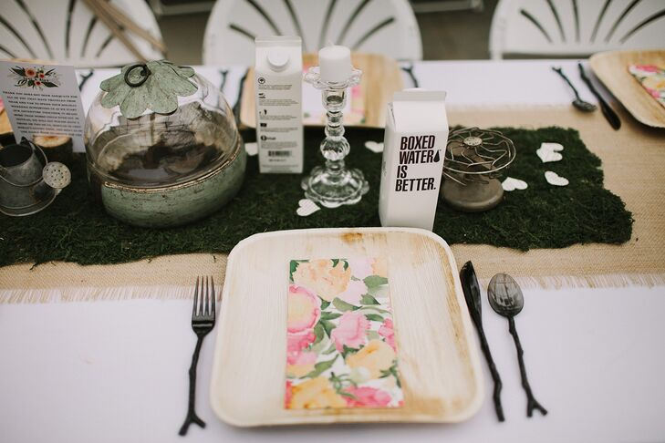 Each seat at the dining table had twig-shaped silverware positioned next to square wooden plates, topped with a colorful floral napkins that made the arrangement pop.