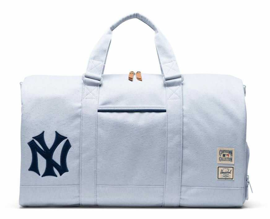 gray vintage inspired sports duffle with yankees logo on left side