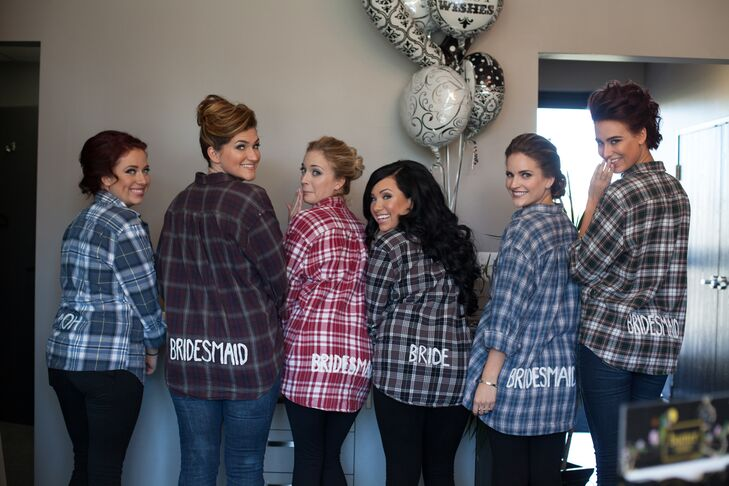 The bridal party spent the morning of the wedding getting ready in custom-made plaid shirts.