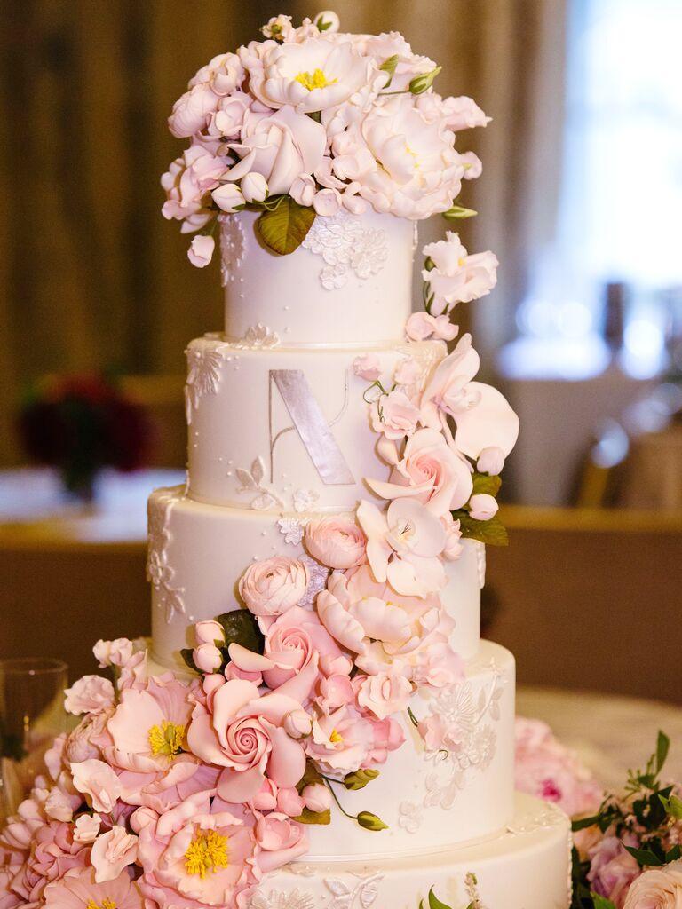 Lavish Cascading Blush Flowers And Floral Embossing Sugar Wedding Cake