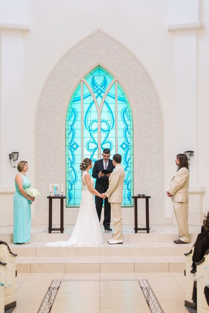 The bridesmaids stood by Cami in sweet light blue dresses with illusion halter necklines from David's Bridal. Their pearl accessories also Cami's wedding jewelry. The groomsmen wore neutral suits from Men's Wearhouse with Tiffany blue vests to match.