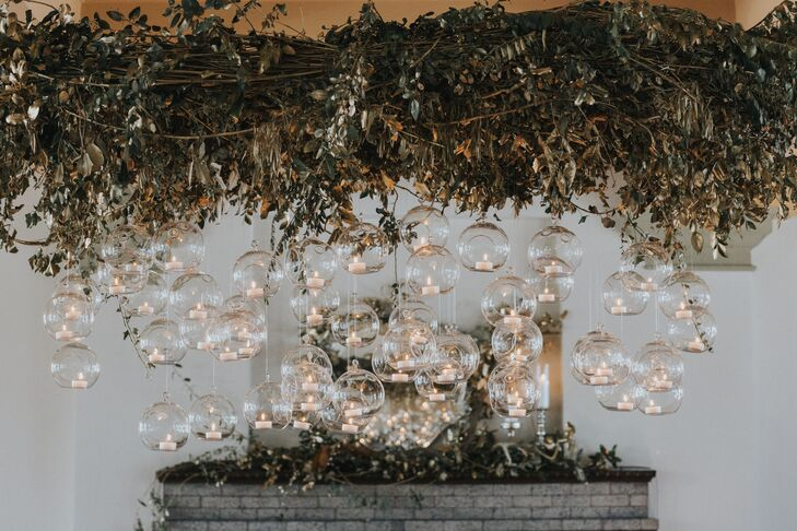 Lauren and Johnny created a chandelier of greenery and suspended candles.