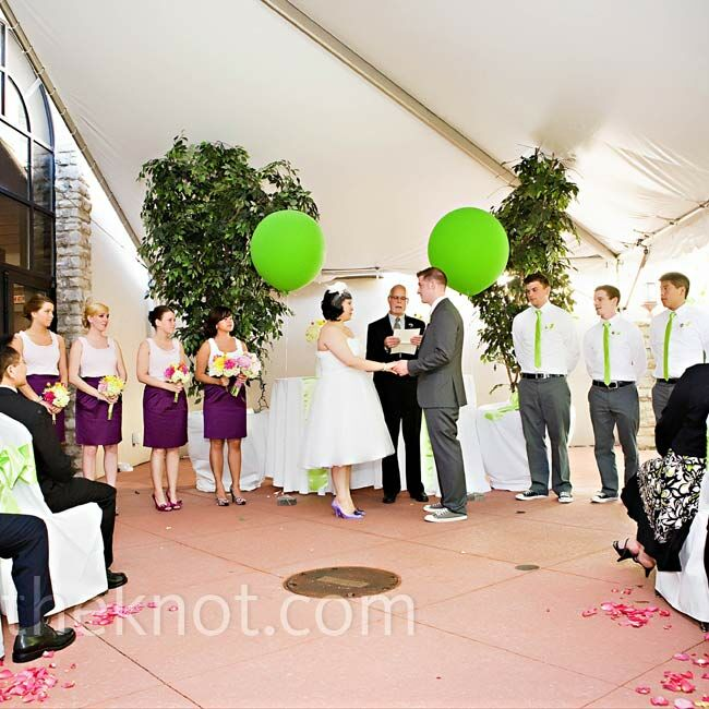 A few scattered pink rose petals lined the aisle and two large lime green balloons at the altar were all the decor the ceremony space needed.