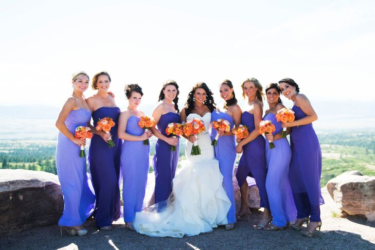 The bridesmaids wore two different shades of purple dresses designed by Dessy.