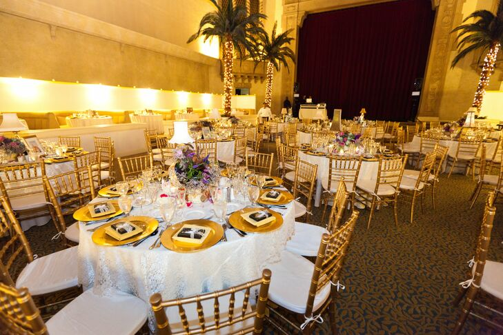 Live palm trees, amber lighting, gold chargers and lace linens created a romantic atmosphere at the reception.