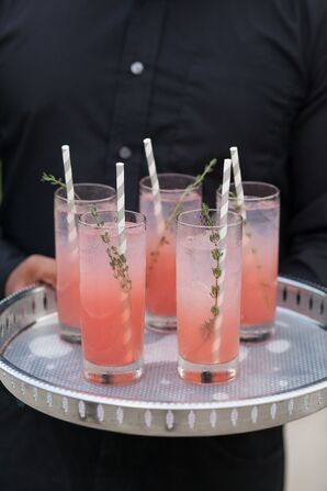 Pink Signature Cocktails with Thyme Garnish