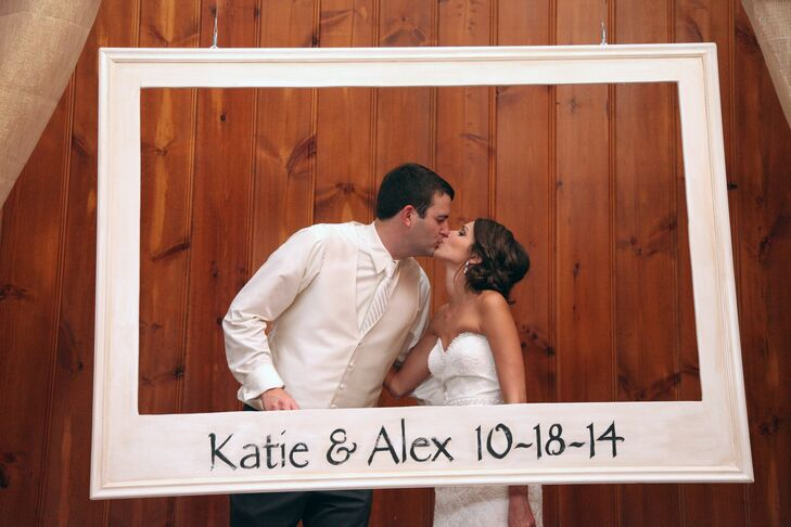 A photo booth was set up for guests to enjoy throughout the night. Katie's father made a fun polaroid-inspired frame for the booth, customized with the couple's names and their wedding date.