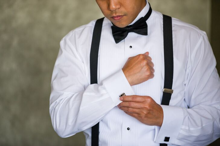 f940d6482875 The groom and his groomsmen wore traditional black tuxedos and suspenders  from Formally Modern.