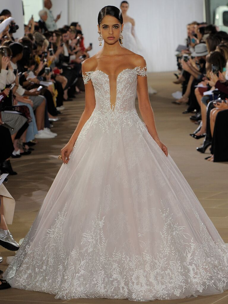 Ines Di Santo Fall 2019 floral-embroidered ball gown wedding dress with a plunging neckline and off-the-shoulder bodice