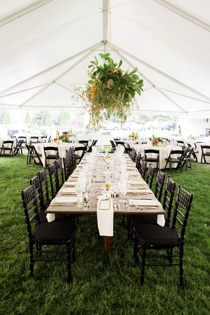 Kassie's dad hung the floral centerpiece over the head table, creating an elegant effect in the modern tent reception.