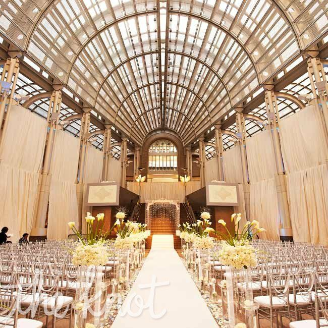 Silver chiavari chairs, a crystal altar canopy and dramatic arrangements set an upscale tone.