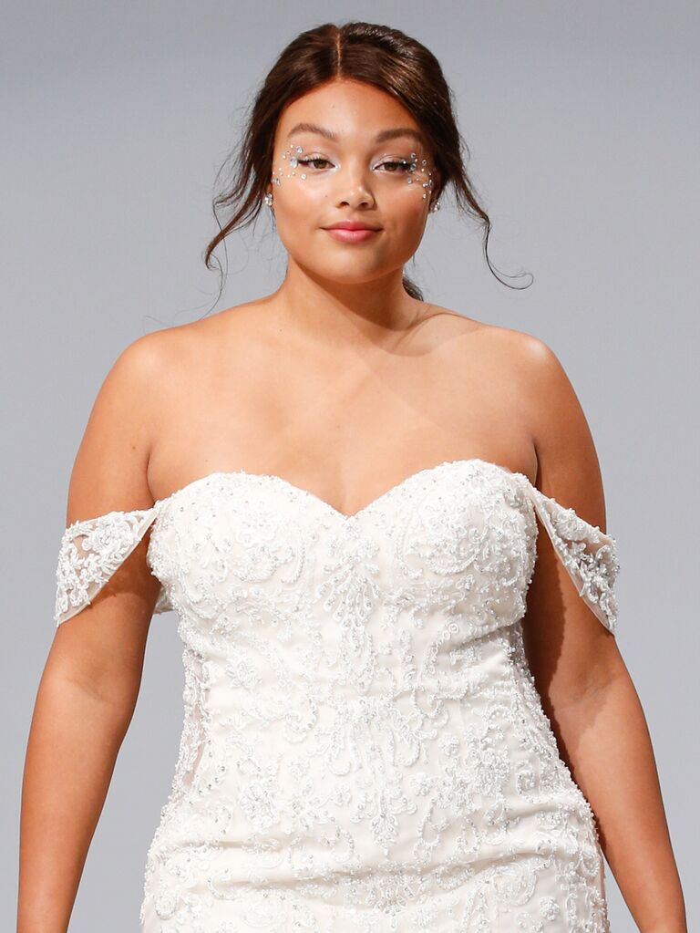 A Criss Cross Bodice Tops This Chiffon Gown And A Ruched Crystal